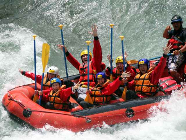 Make a big smile after rafting torrents